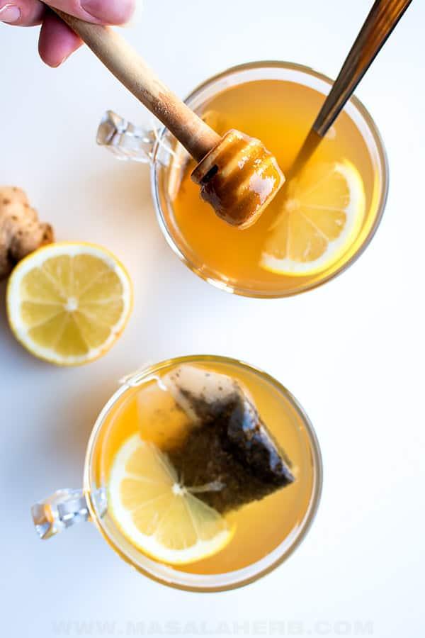 dropping honey into ginger lemon tea bird's eye view