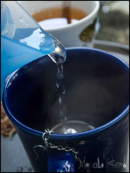 pouring hot water into cup