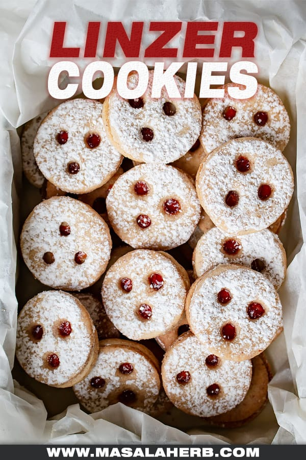 linzer cookies in a tin box