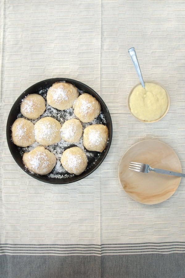 Buchteln stuffed with Hazelnut Paste and topped with Vanilla Sauce #stepbystep #recipe masalaherb.com