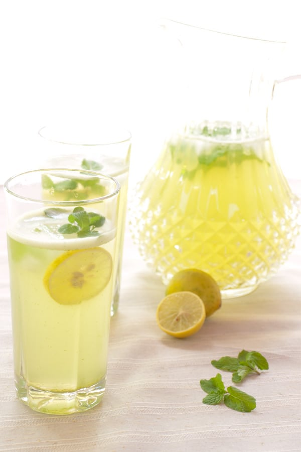 middle eastern mint lemonade aka limonana in a glass and pitcher