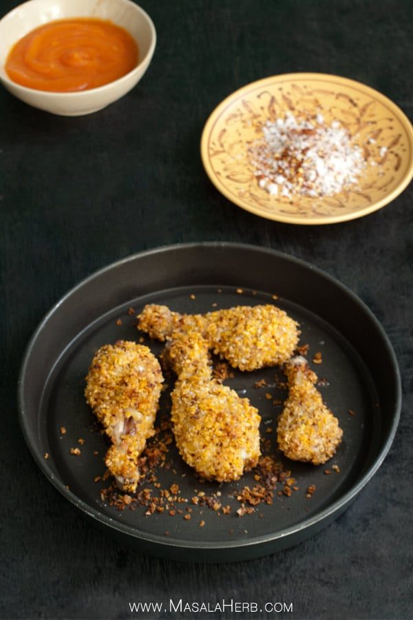 Golden Baked Chicken Drumsticks with Corn Flakes Coconut and Chili Flakes www.MasalaHerb.com