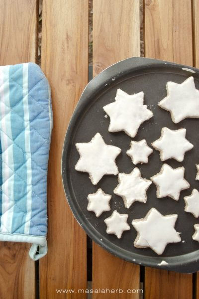Zimtsterne Recipe - German Cinnamon Star Cookies [Gluten-Free]. perfect cookies to surprise your loved ones this winter. Tasty, moist, lightly spiced and enriched with cinnamon + almonds. Get the step by step instructions with pictures for the Zimtsterne. www.Masalaherb.com #cinnamon #stars #cookies #christmas #masalaherb