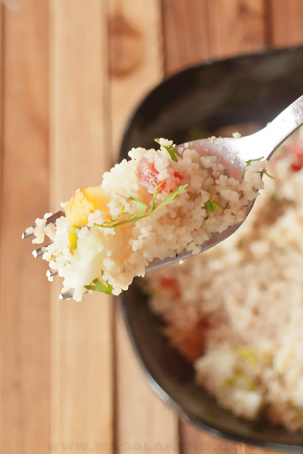 fluffy couscous salad in a fork