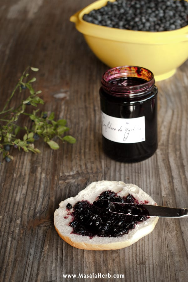 Blueberry jam on a slice of bread roll image