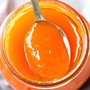 homemade apricot jam in a spoon