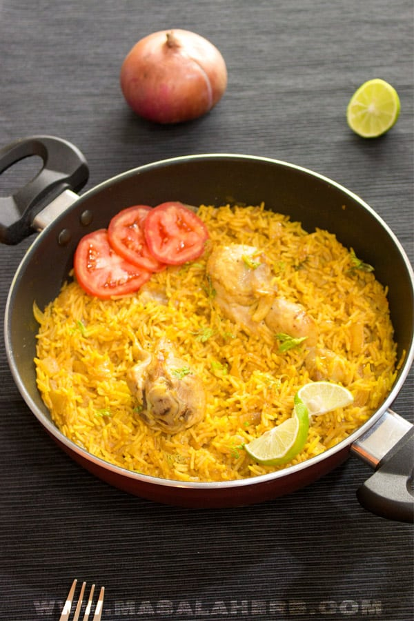 One-Pot Chicken and Rice Recipe - Easy flavorful 15 min weeknight meal [+VIDEO] Make a dinner for two. Yellow golden rice and aromatic spices for the senses. A comfortably easy dish to prepare from scratch. www.MasalaHerb.com #masalaherb #chicken #rice #onepot #weeknightdinner