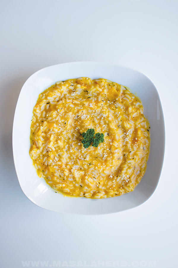 butternut squash risotto served in a plate