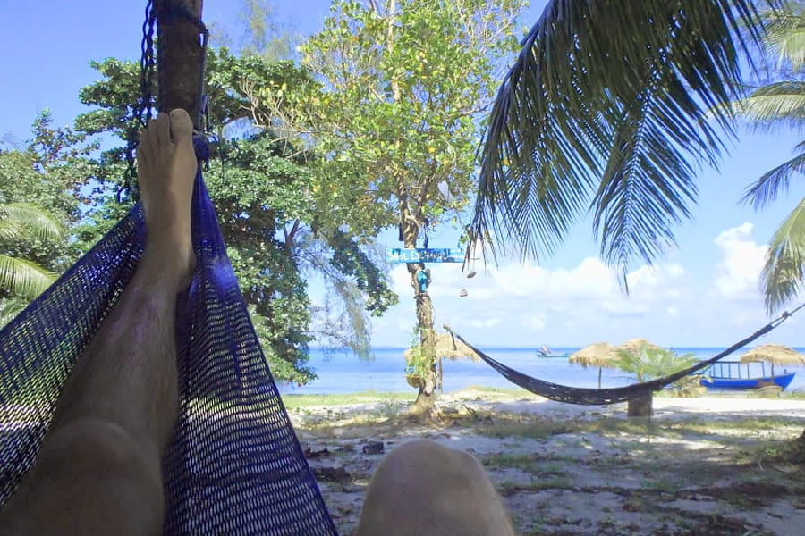 digital nomad at the beach in a hammock