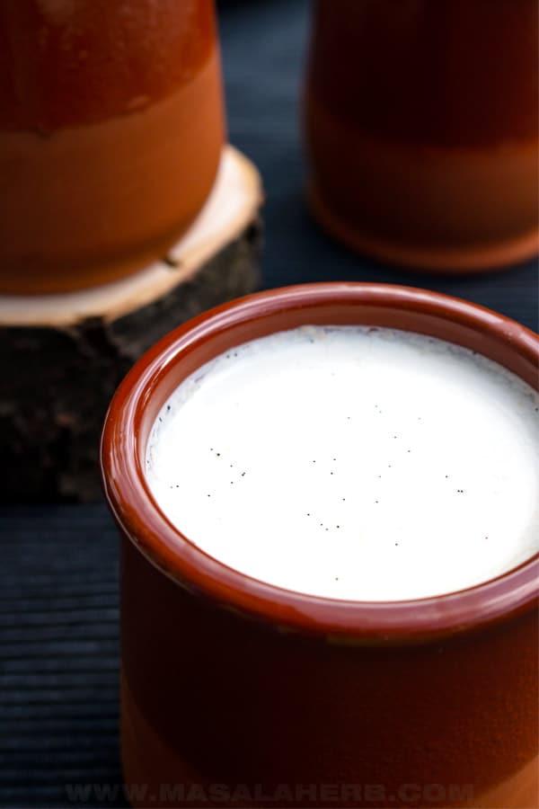 vanilla flavored yogurt in a clay pot