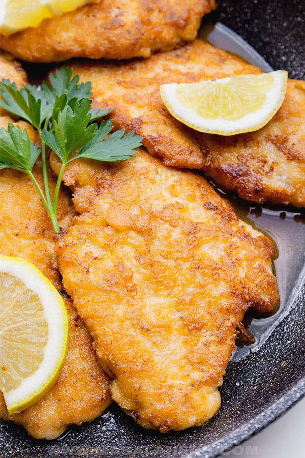 Italian piccata meat cutlet milanese style