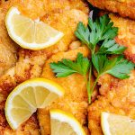 chicken piccata milanese style cutlets with lemon slices