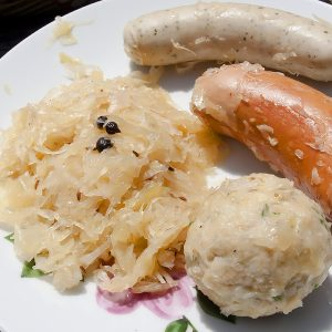 Sauerkraut bread dumpling and sausages on a plate