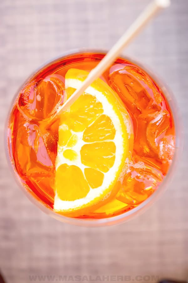 aperol spritz in a glass with orange slice and ice cubes