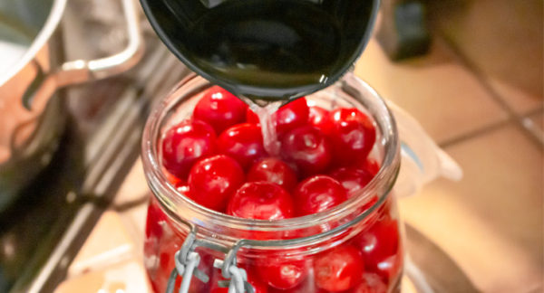 pour water sugar over cherries