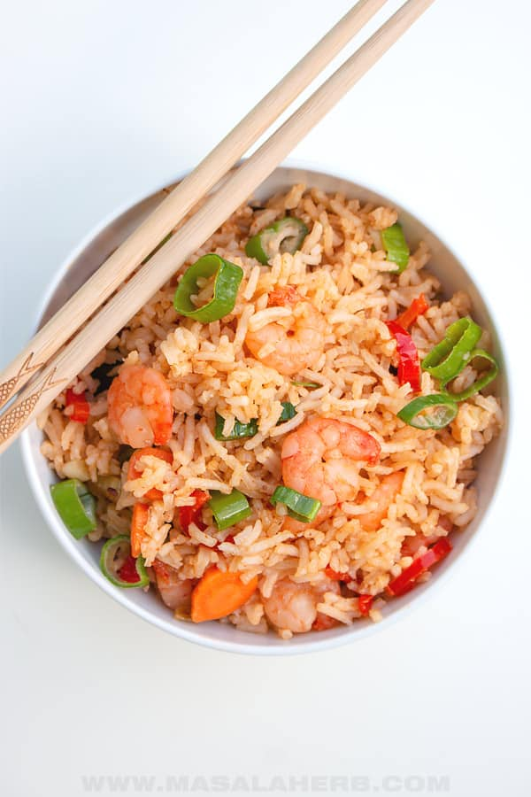bird's eyes view of shrimp fried rice in a bowl with chopsticks