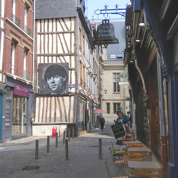 side road in Rouen with street art of Jean D'arc
