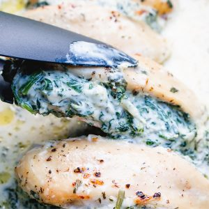picking up a spinach crema cheese stuffed chicken breast