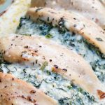 close up of chicken stuffed spinach
