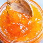fruit preserve with kumquat in a spoon and jar