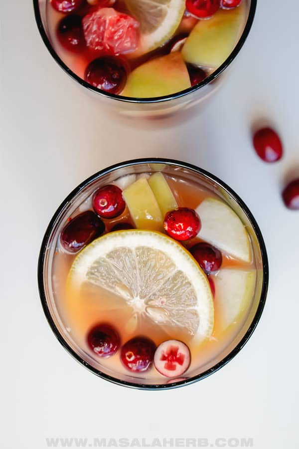 punch infused with fruits served in glasses