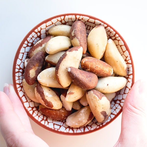 a small bowl with brazil nuts