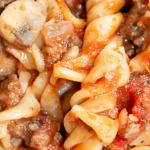 baked pasta with ground beef casserole close up