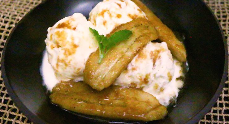 top vanilla ice cream with hot banana foster