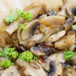sauteed mushrooms in a skillet close up