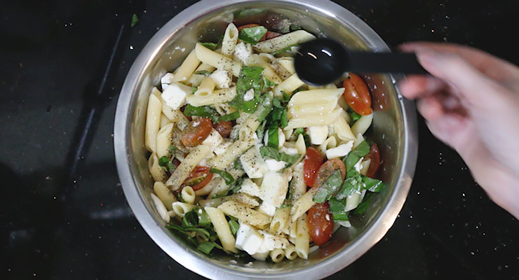 combine all ingredients in a bowl for the caprese pasta sald