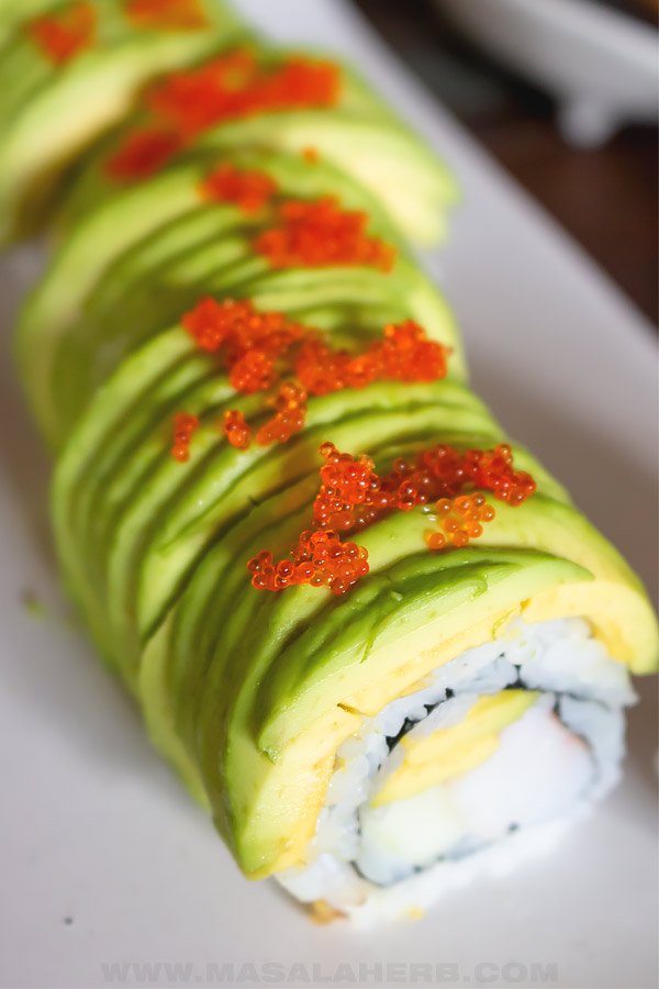 close up of green dragon roll and tobico
