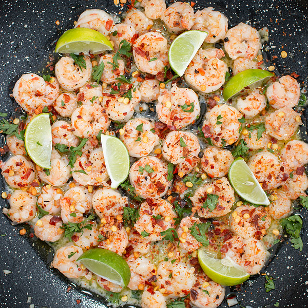 skillet shrimp with lie, butter, garlic, cilantro and crushed red chili pepper