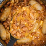 creamy pinto beans with sausages inn a pan