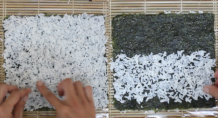 spread sushi rice over nori sheet on both sides