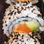 top down view of cut salmon roll