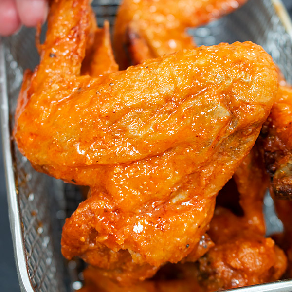 crispy chicken wings coated with buffalo sauce