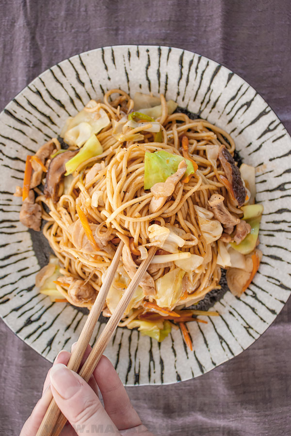 chicken yakisoba with chop sticks in a Japanese plate