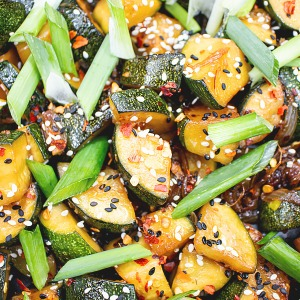 stir fried zucchini topped with sesame and chili flakes