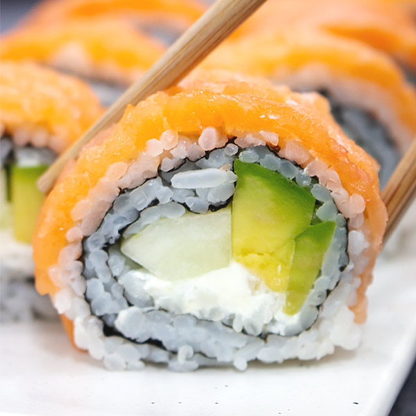 sushi with salmon, cream cheese, avocado and cucumber