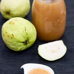 Guava Jam in a bowl with fruit and jar