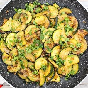 sauteed zucchini in a pan